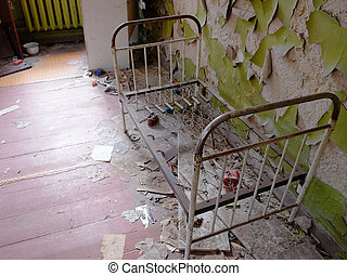 An old metal children's bed in an abandoned kindergarten in Chernobyl.