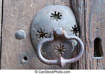 an old metal door handle knocker