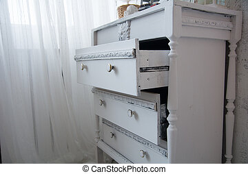 An old painted white ladies chest of drawers
