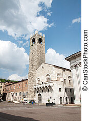 Brescia, Italy - An old palace with tower in the principal ...