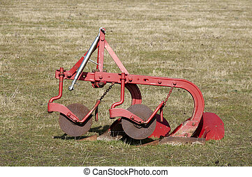plough - An old plough in a field of grass
