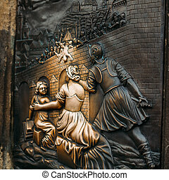 An old relief below the statue of St. John of Nepomuk on Charles