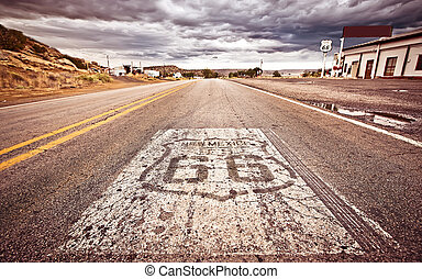 An old Route 66 shield painted on road in NNew Mexico, USA