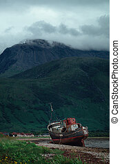 An old ship washed ashore on Loch Linnhe at Fort William on the Highland coast of Scotland
