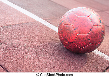 An old soccer ball on the sportsground