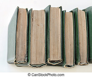 An old stack of green books on the shelf - top view
