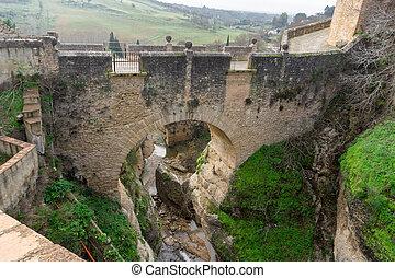 An old stone bridge in the El Tajo Gorge in Ronda in Andalusia