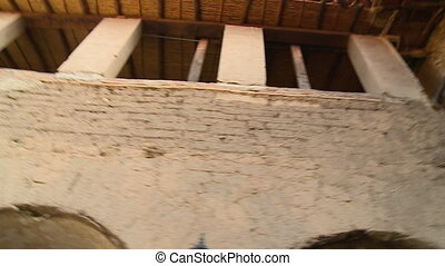 An old storey building with a balcony - A low angle shot of...