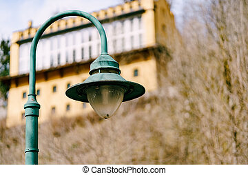 An old street lamp on a metal pole.