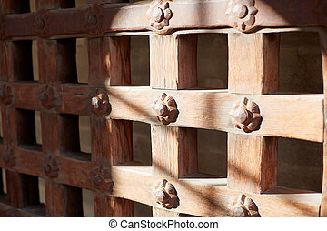 An old sturdy timber portcullis gate or door