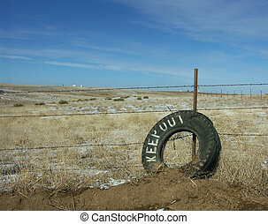Keep Out - An old tire being used as a Keep Out sign in the ...