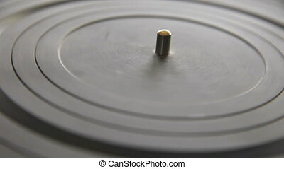 old turntable - an old turntable spins without a record