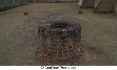 An old well in the fortress - A hand held, tilting, medium...
