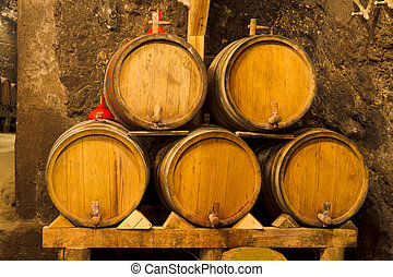 An old wine cellar with oak barrels