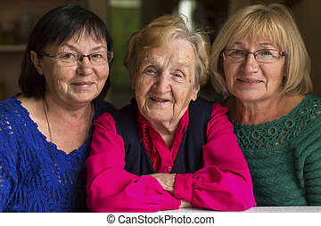 An old woman with grown daughters.