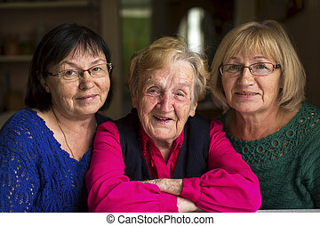 old woman with two adult daughters