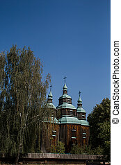 an old wooden church in the forest