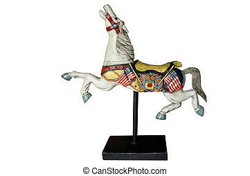an old wooden colourfull horse standing on a base
