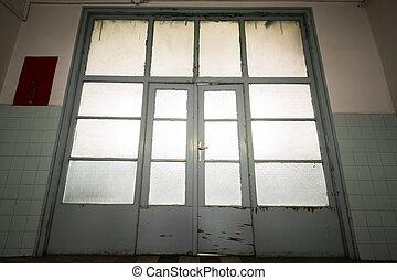 An old wooden door glass, back light