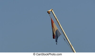 An old wreckage flag on the pole