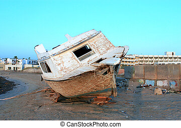 An old wrecked boat on the shore. Safaga, Egypt.