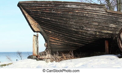 An old wrecked wooden boat