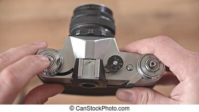An old Zenit-E film SLR camera with an interchangeable...