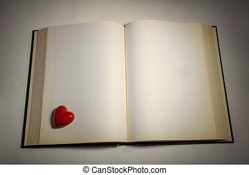 an open book and red heart - Blank white pages in an open...
