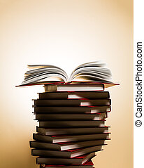 An open book on a stack of red books in the form of a spiral...