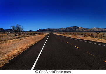 An image of an open highway in the Texas hill country