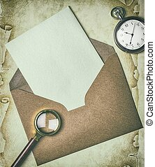 An open envelope with a blank card in a vintage style
