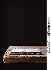 old book on a rustic wooden table