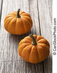 An orange pumpkin on an old wood.