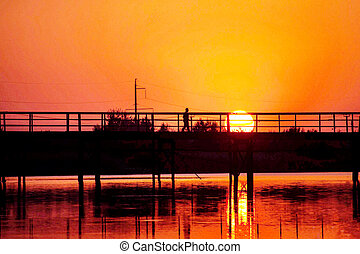 orange sunset over the bridge and river