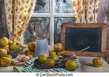 organic apples on the table with small chalkboard