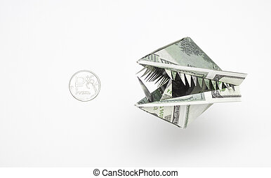 An origami figure of dollars in the form of an animal 's head with teeth and a ruble coin. The concept of the growth of the dollar against the ruble.
