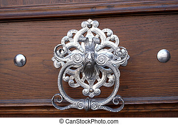 An ornate door knocker