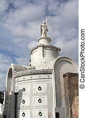 An ornate family tomb in the historic St. Louis Cemetery #1, New Orleans, Louisiana.