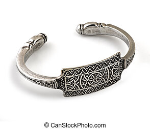 an ornate silver bracelet on a white background