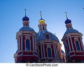 an Orthodox Church on a blue sky background