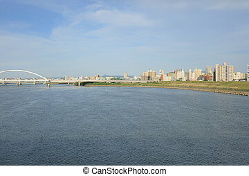 an Osaka, Japan skyline on the Yodogawa River