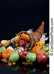 An overflowing cornucopia on a black background