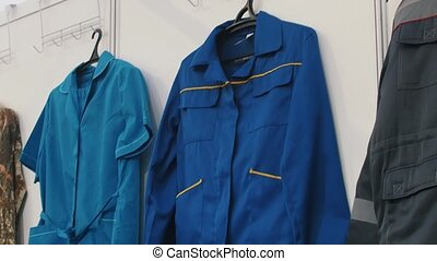 An overview of workers clothes. Outwear jackets close up