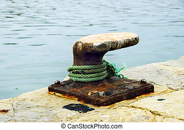 an oxidized mooring of vessels in a port