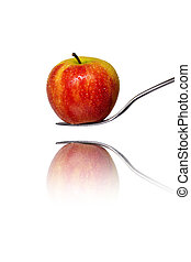 an red apple on a fork with reflection, isolated on white