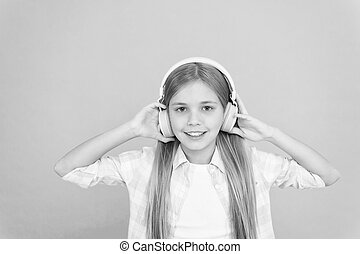 An ultra comfortable fit for her. Adorable music fan. Little girl child listening to music. Happy little child enjoy music playing in headphones. Music makes her happy