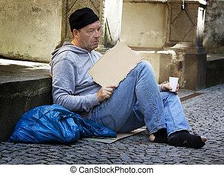 unemployed homeless beggar is - an unemployed homeless...