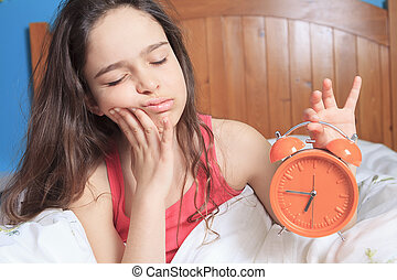unhappy girl waking up - An unhappy girl waking up with ...