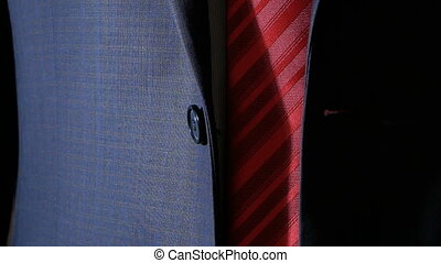 an unrecognizable businessman buttoning a button on his...