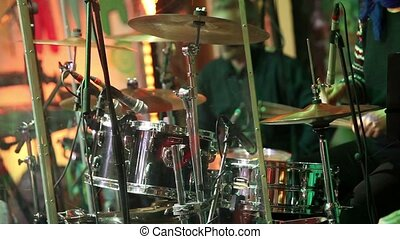 An unrecognizable drummer , a man playing drums, a drummer in a music band, a live performance. Anonymous Drummer Drumming on Stage - Close Up